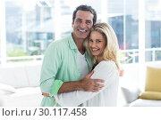 Купить «Mid adult romantic couple hugging at home», фото № 30117458, снято 3 февраля 2016 г. (c) Wavebreak Media / Фотобанк Лори
