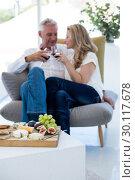 Купить «Couple toasting red wine with food», фото № 30117678, снято 3 февраля 2016 г. (c) Wavebreak Media / Фотобанк Лори