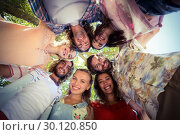Купить «Happy friends forming a huddle in park», фото № 30120850, снято 20 июля 2016 г. (c) Wavebreak Media / Фотобанк Лори