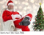 Купить «Sitting Santa against blurry Christmas background», фото № 30122766, снято 23 ноября 2016 г. (c) Wavebreak Media / Фотобанк Лори
