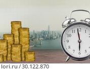 Купить «Clock and coins in front of city», фото № 30122870, снято 23 ноября 2016 г. (c) Wavebreak Media / Фотобанк Лори