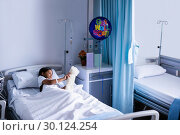 Купить «Patient relaxing on bed with teddy bear», фото № 30124254, снято 5 ноября 2016 г. (c) Wavebreak Media / Фотобанк Лори