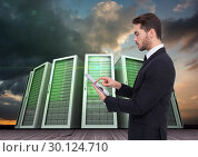 Купить «Businessman using digital tablet against server systems in sky», фото № 30124710, снято 8 декабря 2016 г. (c) Wavebreak Media / Фотобанк Лори