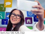 Купить «Digital composite image of a girl clicking selfie», фото № 30125722, снято 16 декабря 2016 г. (c) Wavebreak Media / Фотобанк Лори