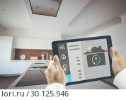 Купить «Hands holding digital tablet with home security icons», фото № 30125946, снято 16 декабря 2016 г. (c) Wavebreak Media / Фотобанк Лори