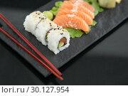 Купить «Sushi with chopsticks», фото № 30127954, снято 8 декабря 2016 г. (c) Wavebreak Media / Фотобанк Лори