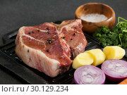 Купить «Sirloin chop and ingredients on black grill», фото № 30129234, снято 20 сентября 2016 г. (c) Wavebreak Media / Фотобанк Лори