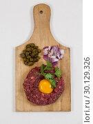 Купить «Beef patty, onions and olives on wooden board», фото № 30129326, снято 20 сентября 2016 г. (c) Wavebreak Media / Фотобанк Лори