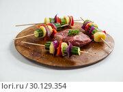 Купить «Sirloin chop and skewered vegetables on wooden board», фото № 30129354, снято 20 сентября 2016 г. (c) Wavebreak Media / Фотобанк Лори
