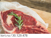 Купить «Sirloin chop and rosemary herb on wooden tray», фото № 30129478, снято 20 сентября 2016 г. (c) Wavebreak Media / Фотобанк Лори