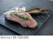 Купить «Sirloin chop, spics and garlic on slate plate», фото № 30129650, снято 20 сентября 2016 г. (c) Wavebreak Media / Фотобанк Лори