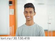 Купить «Portrait of smiling schoolboy in classroom», фото № 30130418, снято 19 ноября 2016 г. (c) Wavebreak Media / Фотобанк Лори