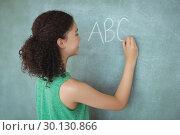 Купить «Schoolgirl pretending to be a teacher in classroom», фото № 30130866, снято 20 ноября 2016 г. (c) Wavebreak Media / Фотобанк Лори