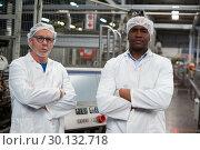 Купить «Portrait of two factory engineers standing with arms crossed», фото № 30132718, снято 20 октября 2016 г. (c) Wavebreak Media / Фотобанк Лори