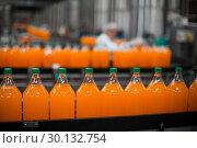 Купить «Bottle of juice processing on production line», фото № 30132754, снято 20 октября 2016 г. (c) Wavebreak Media / Фотобанк Лори