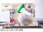 Купить «Professional contractor doing pest control at office», фото № 30133486, снято 16 ноября 2018 г. (c) Elnur / Фотобанк Лори