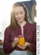 Купить «Shop assistant holding a jar of pickle», фото № 30134258, снято 4 октября 2016 г. (c) Wavebreak Media / Фотобанк Лори