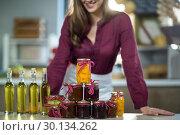 Купить «Olive oil, jam, pickle placed together on table», фото № 30134262, снято 4 октября 2016 г. (c) Wavebreak Media / Фотобанк Лори