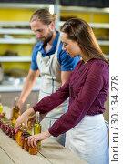 Купить «Shop assistants arranging jam and pickle jars», фото № 30134278, снято 4 октября 2016 г. (c) Wavebreak Media / Фотобанк Лори