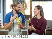 Купить «Shop assistants interacting while holding olive oil and pickle bottles», фото № 30134282, снято 4 октября 2016 г. (c) Wavebreak Media / Фотобанк Лори