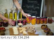 Купить «Olive oil, jam, pickle placed together on table», фото № 30134294, снято 4 октября 2016 г. (c) Wavebreak Media / Фотобанк Лори