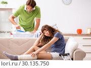 Купить «Husband helping leg injured wife in housework», фото № 30135750, снято 4 октября 2018 г. (c) Elnur / Фотобанк Лори