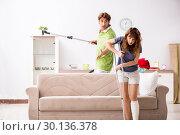 Купить «Husband helping leg injured wife in housework», фото № 30136378, снято 4 октября 2018 г. (c) Elnur / Фотобанк Лори