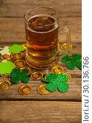 Купить «Mug of beer, chocolate gold coins and shamrock for St Patricks Day», фото № 30136766, снято 11 января 2017 г. (c) Wavebreak Media / Фотобанк Лори