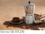 Купить «Coffee beans, coffee, coffeemaker and scoop», фото № 30137270, снято 6 октября 2016 г. (c) Wavebreak Media / Фотобанк Лори