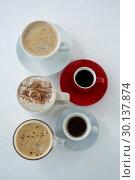 Купить «Different types of coffee arranged on white background», фото № 30137874, снято 6 октября 2016 г. (c) Wavebreak Media / Фотобанк Лори