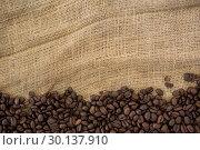 Купить «Coffee beans arranged on sack», фото № 30137910, снято 6 октября 2016 г. (c) Wavebreak Media / Фотобанк Лори