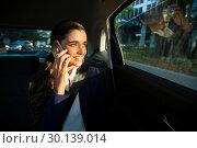 Купить «Business executive talking on mobile phone in car», фото № 30139014, снято 5 октября 2016 г. (c) Wavebreak Media / Фотобанк Лори