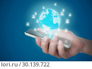 Composite image of cropped image of person holding mobile phone. Стоковое фото, агентство Wavebreak Media / Фотобанк Лори
