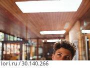 Купить «Thoughtful schoolboy looking up in corridor», фото № 30140266, снято 19 ноября 2016 г. (c) Wavebreak Media / Фотобанк Лори