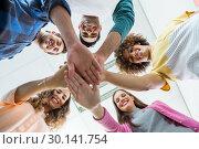 Купить «Team of smiling executives forming hand stack», фото № 30141754, снято 23 ноября 2016 г. (c) Wavebreak Media / Фотобанк Лори