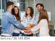 Купить «Group of business people forming a hand stack», фото № 30141854, снято 23 ноября 2016 г. (c) Wavebreak Media / Фотобанк Лори