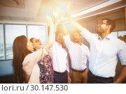 Купить «Business colleagues giving high five during meeting in office», фото № 30147530, снято 26 ноября 2016 г. (c) Wavebreak Media / Фотобанк Лори