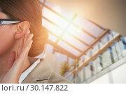Купить «Composite image of close up of businesswoman listening carefully», фото № 30147822, снято 21 мая 2017 г. (c) Wavebreak Media / Фотобанк Лори