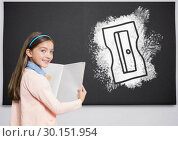 Купить «Pencil sharpener on blackboard with girl reading», фото № 30151954, снято 24 июля 2017 г. (c) Wavebreak Media / Фотобанк Лори