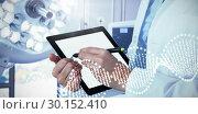 Купить «Composite image of midsection of female doctor using digital tablet with stylus», фото № 30152410, снято 9 августа 2017 г. (c) Wavebreak Media / Фотобанк Лори