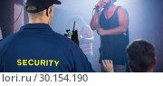 Купить «Composite image of rear view of security officer talking on walkie talkie», фото № 30154190, снято 12 января 2018 г. (c) Wavebreak Media / Фотобанк Лори