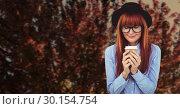 Купить «Autumn leaves and woman drinking from disposable cup», фото № 30154754, снято 1 октября 2018 г. (c) Wavebreak Media / Фотобанк Лори