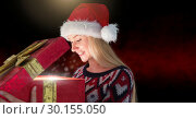 Купить «Excited woman opening magical Christmas gift box with sparkling light», фото № 30155050, снято 1 октября 2018 г. (c) Wavebreak Media / Фотобанк Лори