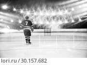 Купить «Composite image of rear view of player holding ice hockey stick», фото № 30157682, снято 15 ноября 2018 г. (c) Wavebreak Media / Фотобанк Лори