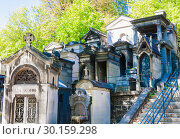 Купить «A view of the Pere Lachaise, the most famous cemetery of Paris, France, with the tombs of very famous people», фото № 30159298, снято 9 сентября 2018 г. (c) Николай Коржов / Фотобанк Лори