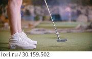 Купить «A young woman playing mini golf indoors», видеоролик № 30159502, снято 25 марта 2019 г. (c) Константин Шишкин / Фотобанк Лори