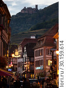 Купить «France, Ribeauville - Main street in the picturesque town on the Wine Route in Alsace», фото № 30159614, снято 29 октября 2014 г. (c) Caro Photoagency / Фотобанк Лори