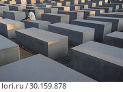 Купить «Berlin, Germany, field of stelae of the Holocaust Memorial in Berlin-Mitte», фото № 30159878, снято 8 сентября 2014 г. (c) Caro Photoagency / Фотобанк Лори