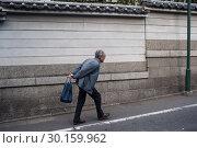 Купить «Kyoto, Japan, elderly man with shopping bag », фото № 30159962, снято 23 декабря 2017 г. (c) Caro Photoagency / Фотобанк Лори