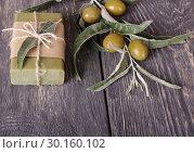 Купить «Olive handmade soap for body care on dark boards», фото № 30160102, снято 4 июля 2018 г. (c) Сергей Молодиков / Фотобанк Лори